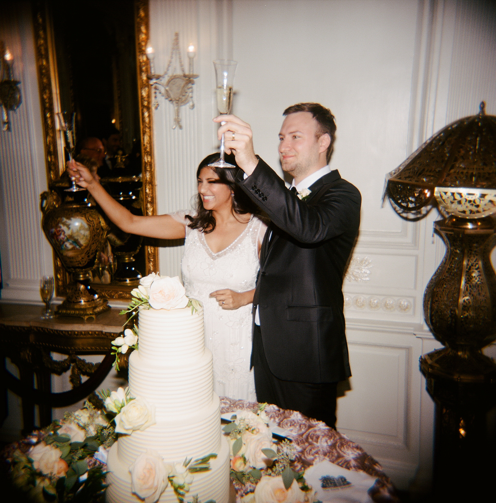 the elms mansion new orleans wedding cake toasting 02