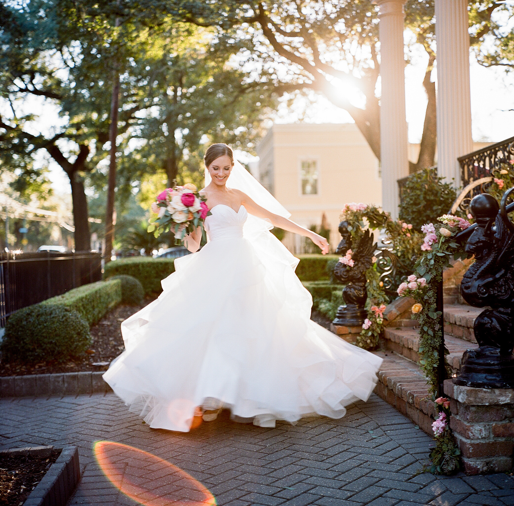 bride twirls in dress at elms mansion in new orleans
