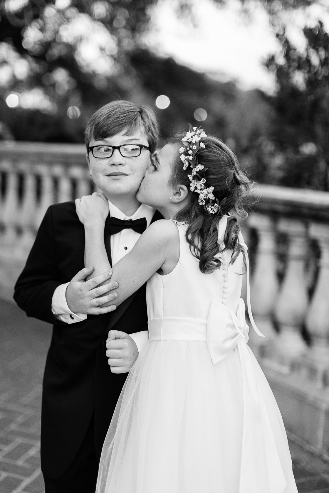 flower girl kissing ring bearer at audubon park