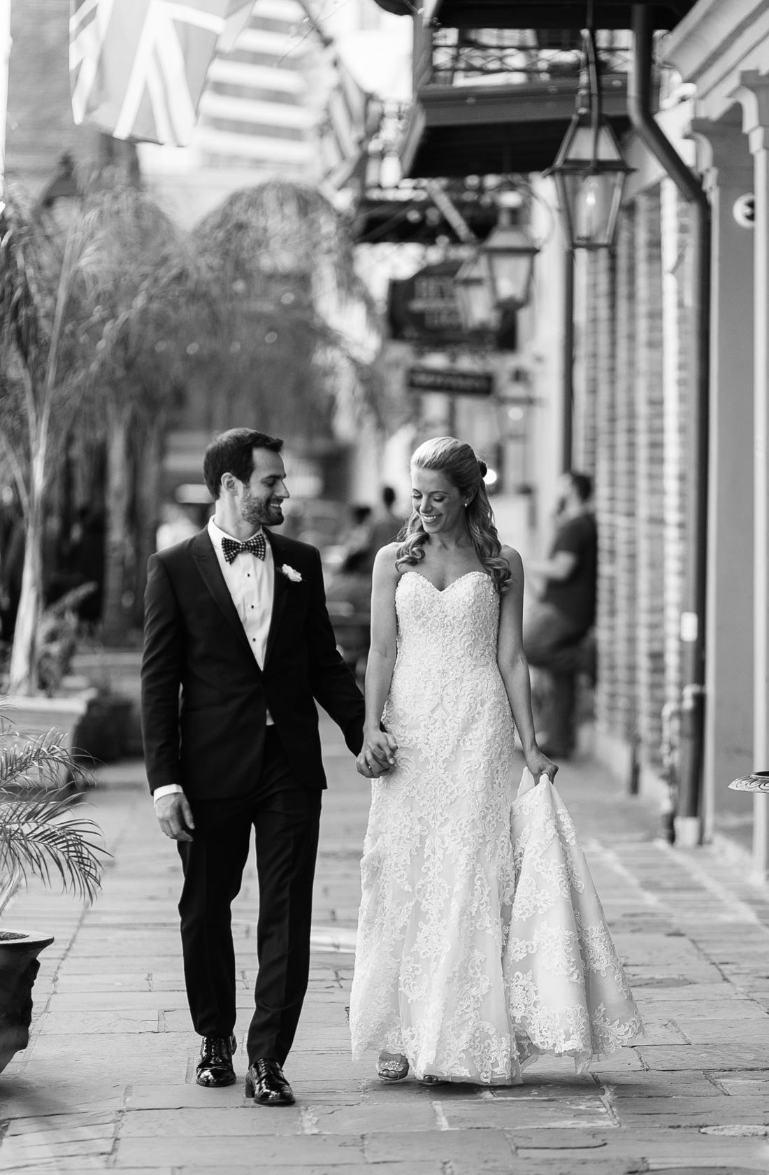 omni royal orleans wedding bride and groom walking in quarter