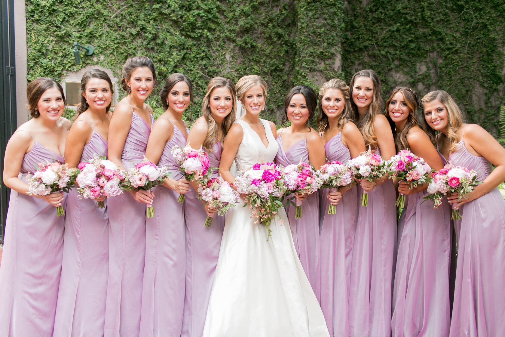 light purple bridesmaid dresses with pops of pink flowers