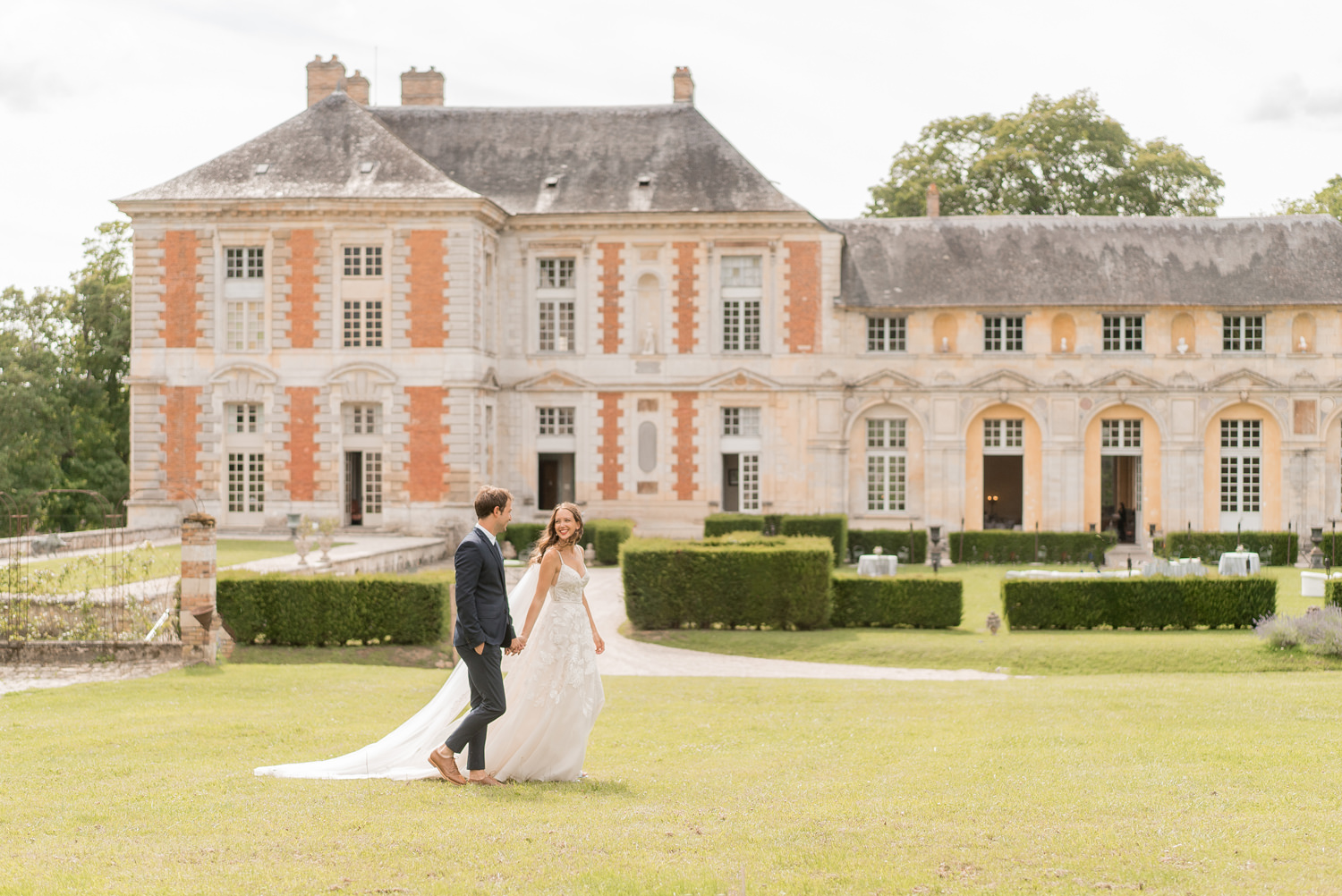 chateau de vallery bride and groom walking together