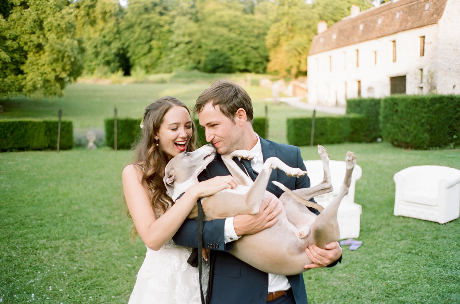 bride and groom with whippet