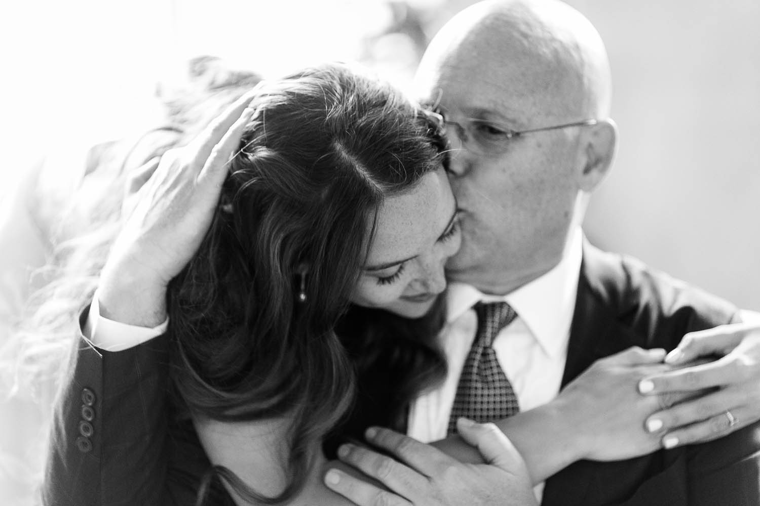 chateau de vallery wedding bride and father embrace