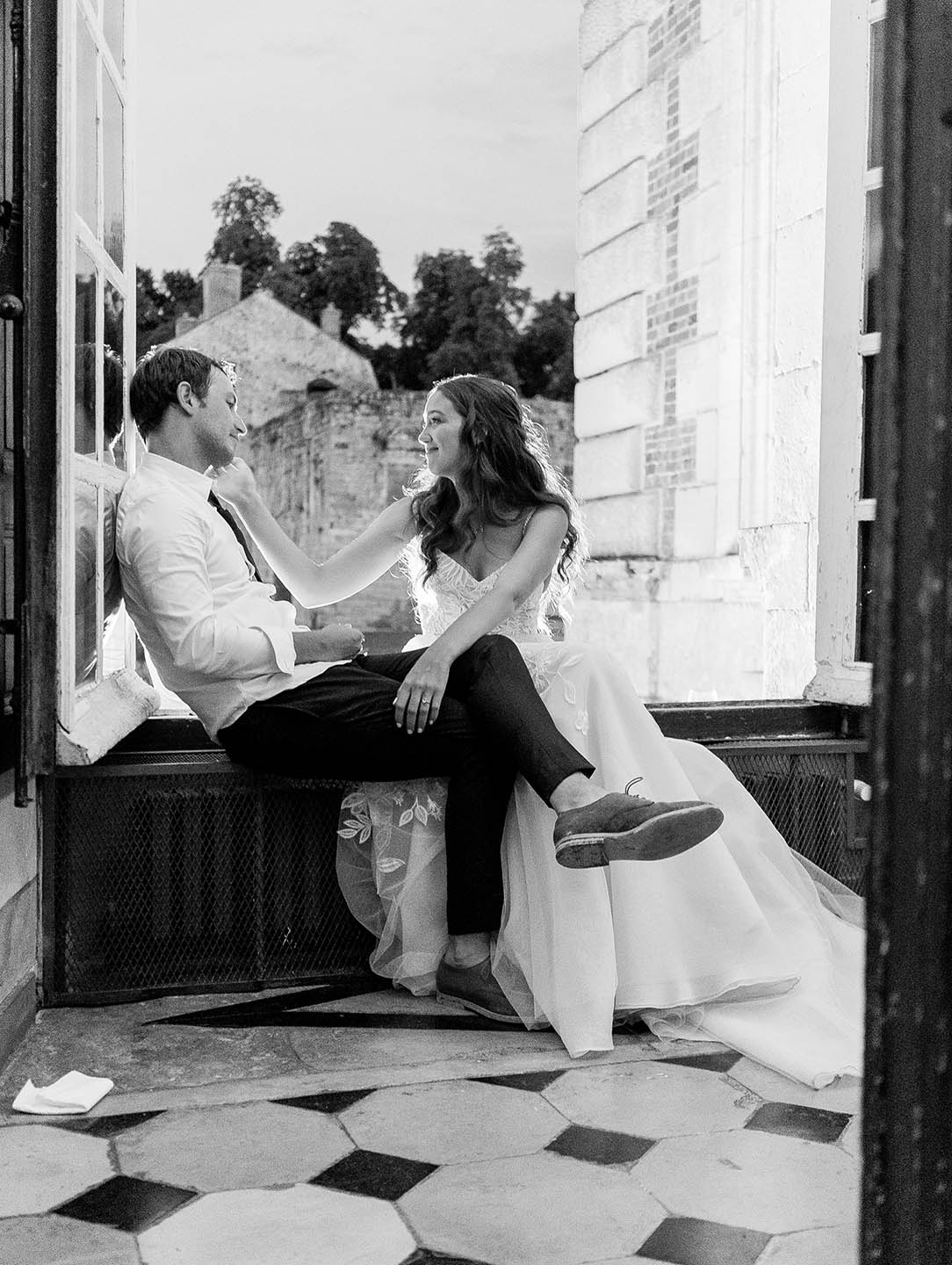 bride and groom share a quiet moment at chateau de vallery wedding