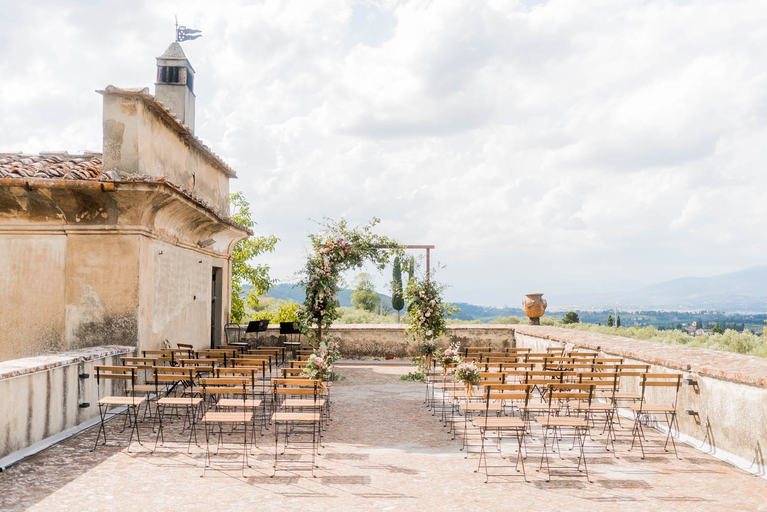 wedding ceremony set up in tuscany at medicea di lilliano