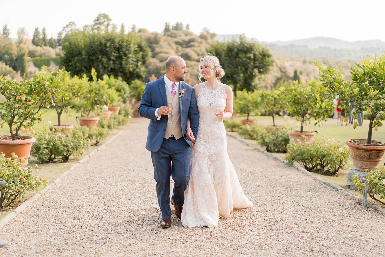 bride and groom walking at medicea di lilliano in tuscany