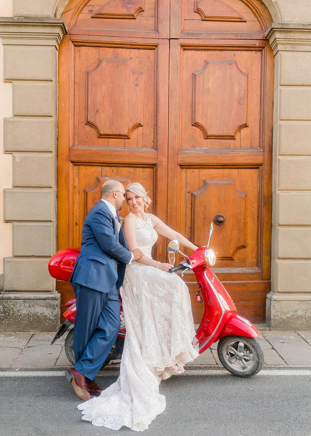bride and groom portrait on a vespa in tuscany italy