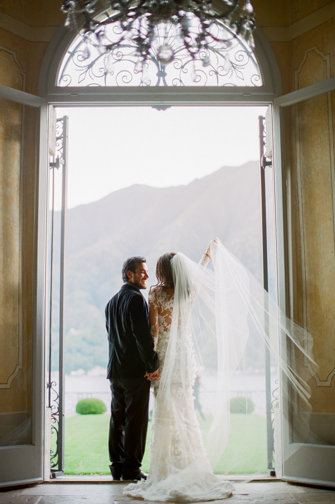 lake como bride and groom exiting villa balbiano