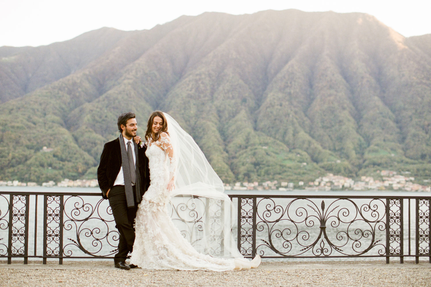 lake como bride and groom posing at villa balbiano