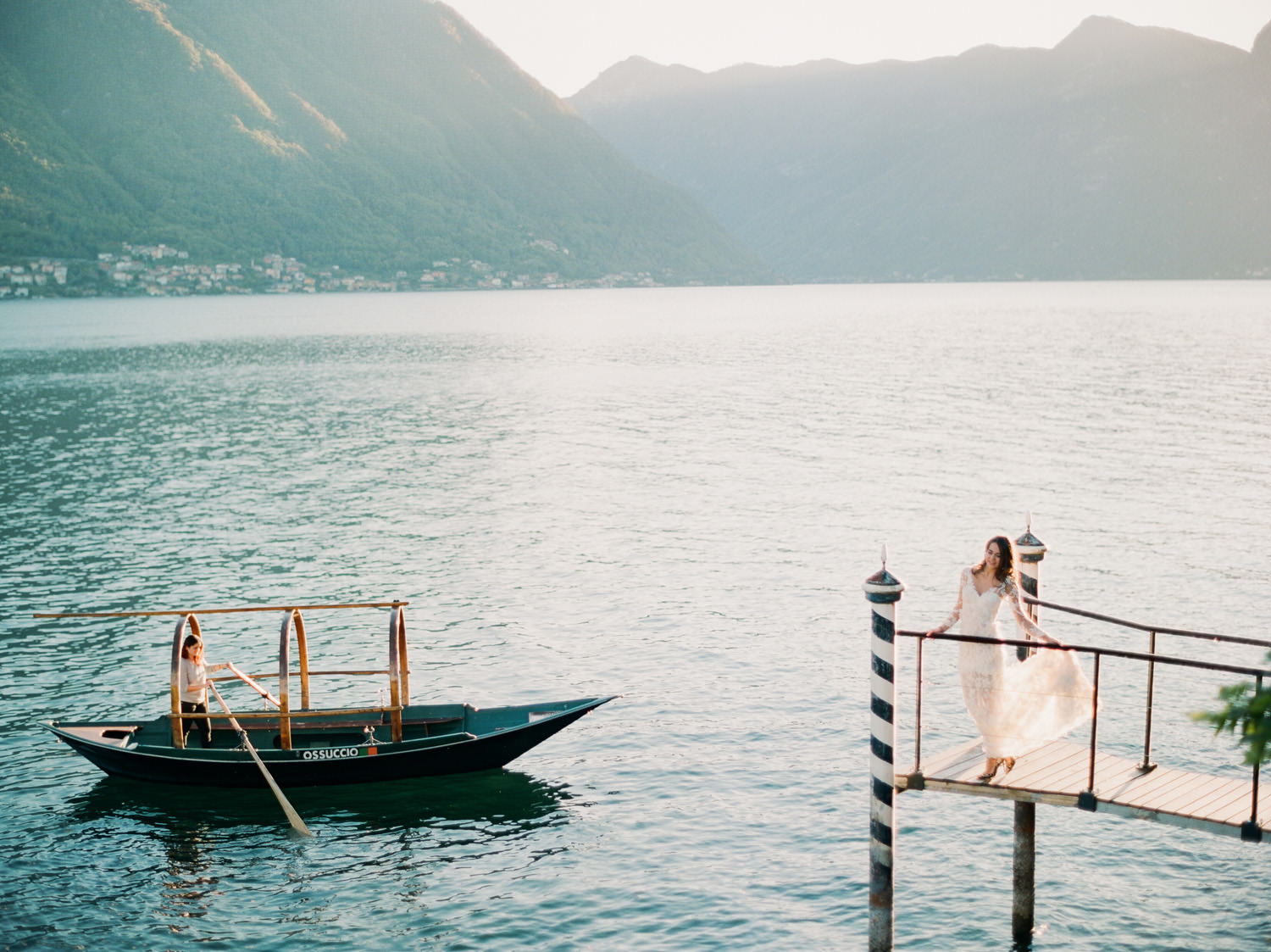villa balbiano view of lake como with bride on dock and boat