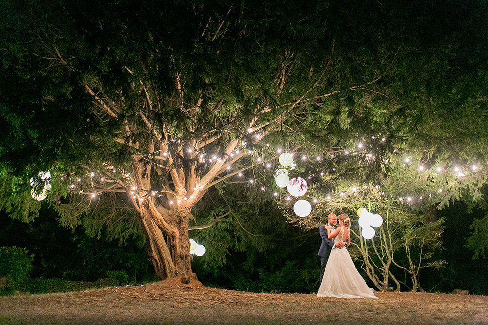 chateau st laborde loire valley wedding bride and groom dance under the trees